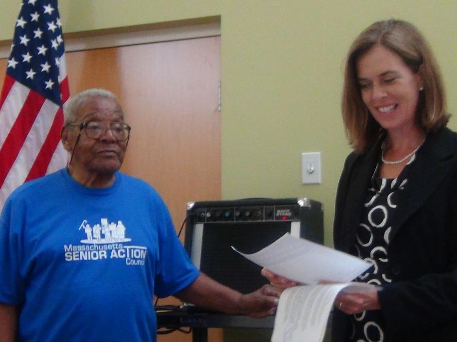 Ed Clark hands over Social Security acknowledgement to Congresswoman
