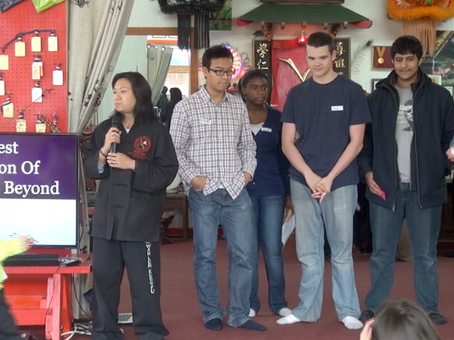 Mai Du (left with teen leaders presenting the program