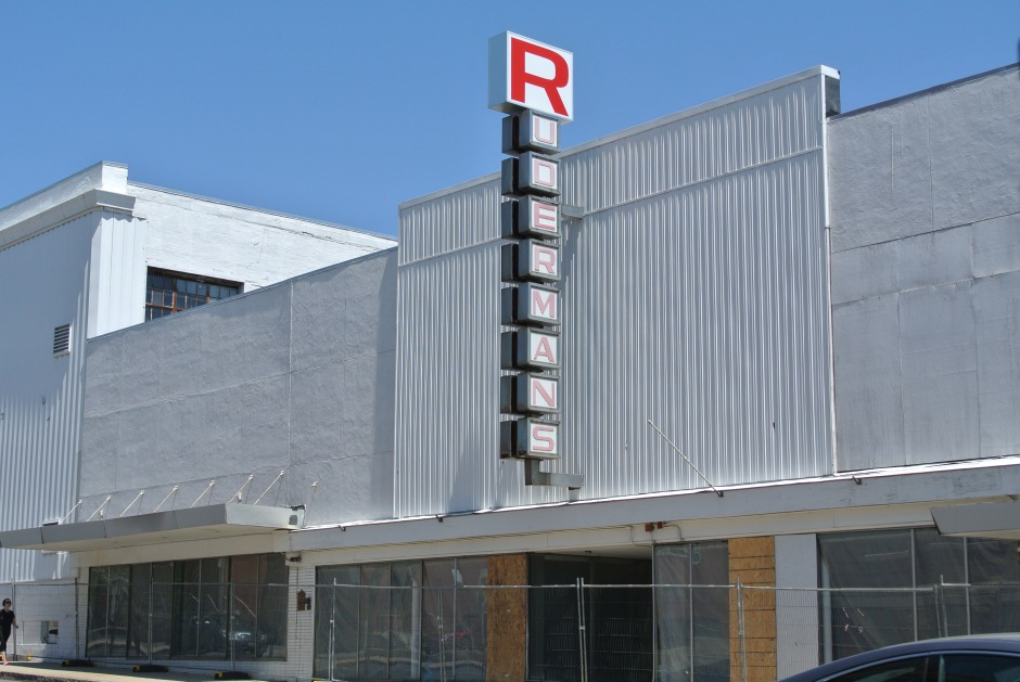The large, modern Ruderman's storefront was erected in 1958.  The sign stayed in place thereafter, despite the closure of Ruderman's and new business operations within the building.