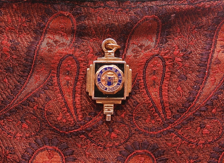 In the 1960's Ruderman's presented seniors at Malden High School with graduation gifts.  In 1964, the business gave graduating female seniors a small cedar hope chest, and a charm, pictured.  Charm donated for this article by Connie Doherty.
