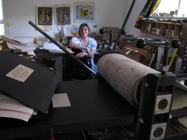 Stephanie Mahan Stigliano in her art studio with printing press