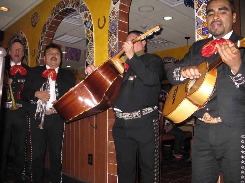 Members of Mariachi Estamwa de America serenading diners