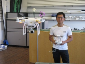 Minh Le, Owner, demonstrating drone in flight