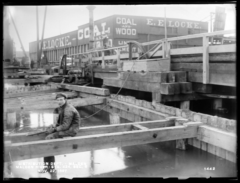 Distribution Department, Low Service Pipe Lines, Malden River crossing, Section 6, station 424, Medford Street, from the west showing where part of the bridge pier was removed, Malden, Mass., Nov. 22, 1897