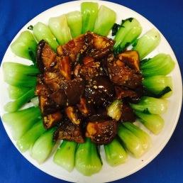 Sauteed Chinese Mushrooms over Greens