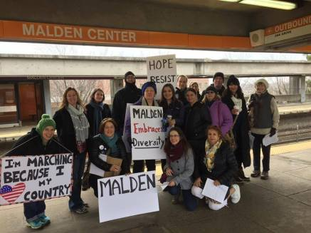 Members from several Malden groups meet up at the Malden Center T stop.