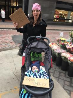 "Maldonian Liz Taegel with baby Max (labelled ""Born Feminist"") in tow."