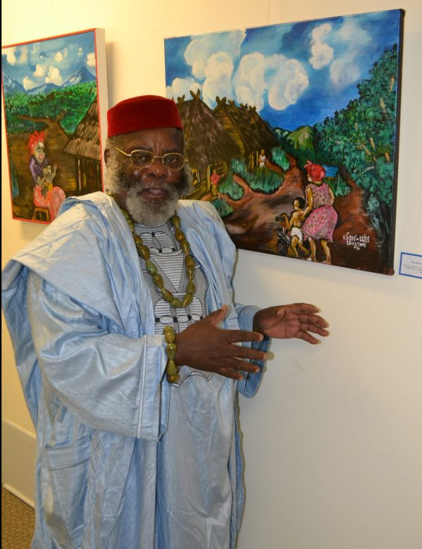 "Artist Efon Elad beside his painting ""Walking the Toddler"""