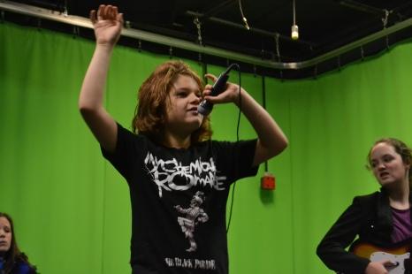 Finn Sedan rocks out while recording a music video