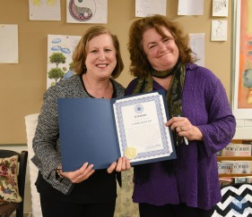 Maria Luise, Assistant to the Mayor, presents a citation to the author. (Photo by Paul Hammersley)