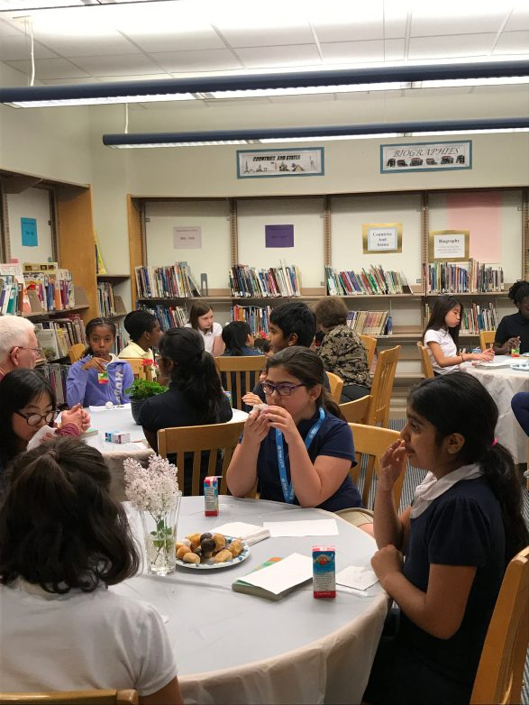 Students have a tea party with elders in the community and discuss the book. (Photo by Jodie Zalk)