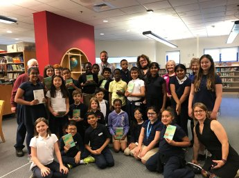 """Students from Ferryway and Beebe Schools who read """"Just My Luck"""" pose with the author. (Photo by Jodie Zalk)"""