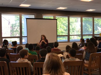 Author Cammie McGovern talks to young students in the Malden High School library. (Photo by Jodie Zalk)