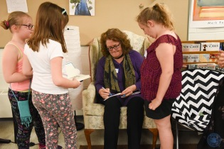 Author Cammie McGovern autographs books for the young readers. (Photo by Paul Hammersley)