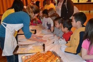 Preparing bread for the Stone Soup meal.