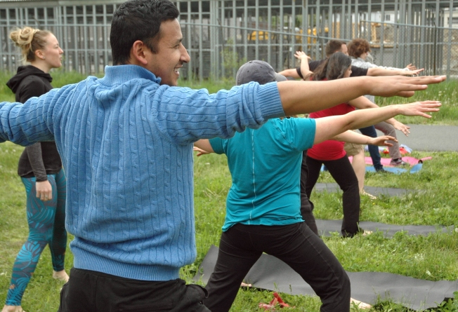 Volunteers take a yoga break under the direction of instructor Kat O'Leary (far left).