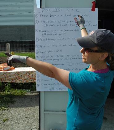 Julie Magnan organizes volunteers for clean up day at the Malden Community Garden.