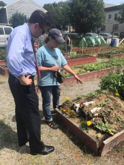 Julie Mangan talks compost with Mayor Gary Christenson.