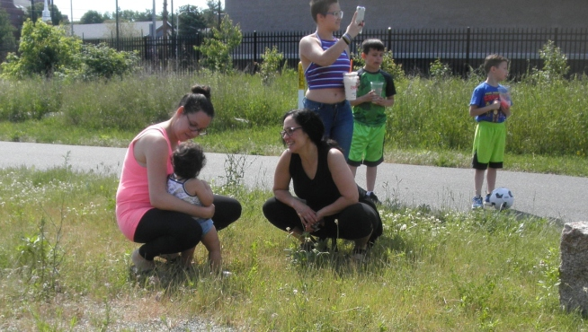 In foreground, Karen Hayes (left) with Julia Hammer-Mendez and daughter, Allegra