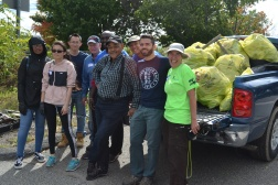 Volunteers including Ryan O'Malley, Ward 4 City Councillor (second from right), after loading the bags in the pick-up truck.