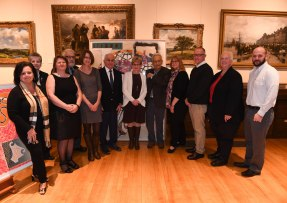 With many of the library trustees - from left: Councilor-at-large Debbie DeMaria, Rita Hashem, Library Director Dora St. Martin, John Tramondozzi, Anne DUrso-Rose, John Giso, Jayne Brown, Frank Stella, Lisa Jacobson, Frank Molis, Martha Dominy, John Moreschi (Photo by Paul Hammersley, 3MG)