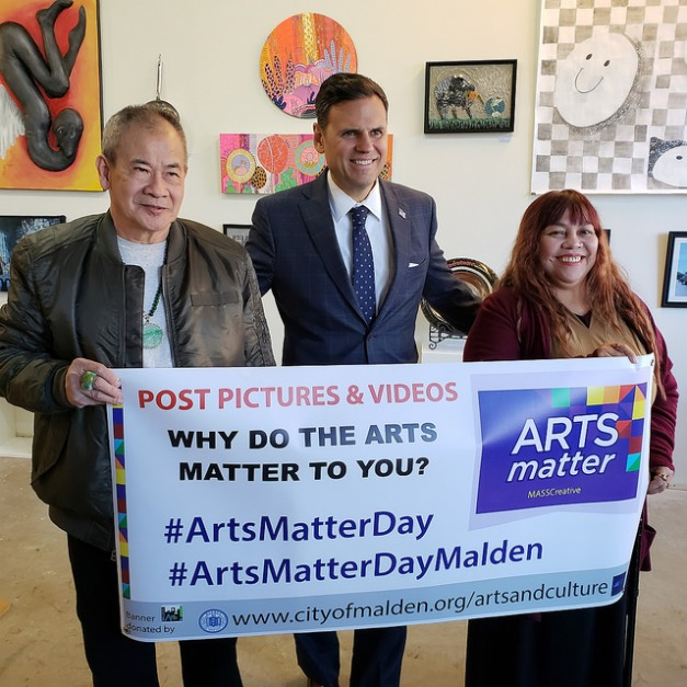 Mayor Gary Christenson is flanked by artist Anna Thai (right) and her brother-in-law, Truong on #ArtsMatterDay, celebrated at The Gallery.