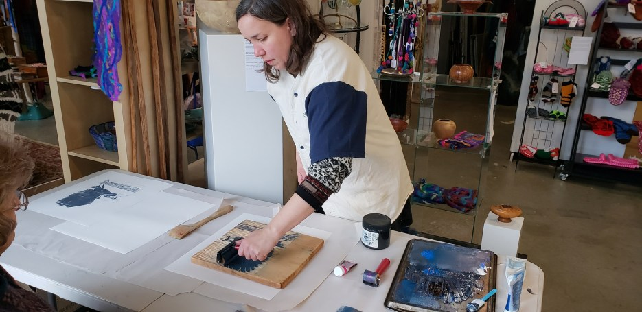 Kari Percival demonstrates printmaking at an Open House event at The Gallery.